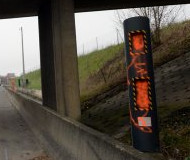 French speed camera spraypainted orange