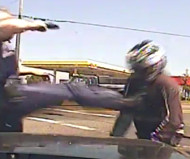 Officer kicks motorcyclist